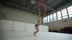 Stock Video Footage of Rhythmic gymnastics: Girl training a gymnastics exercise with a hoop