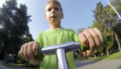 Child in  swing outdoors Stock Footage