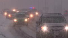 Car accident scene in blizzard and snowstorm in city street Stock Footage