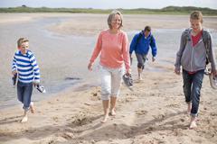 Family outing to the beach - stock photo