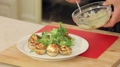 Stock Video Footage of Stuffed champignon on white plate with salad