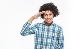 Happy afro american man saluting - stock photo