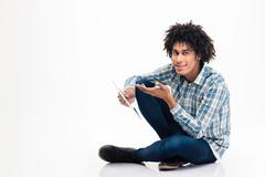 Afro american man holding tablet computer - stock photo