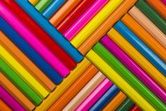 Abstract composition of a set wooden colour pencils. - stock photo