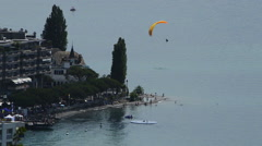 Orange paraglide landing Stock Footage