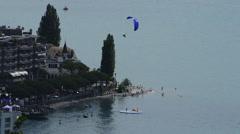 Blue paraglide landing Stock Footage