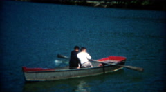 1960: Boys paddling off the rowboat by themselves for the first time. - stock footage
