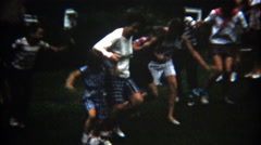 1960: Nighttime 3 legged raced across the lawn where hilarity ensues. Stock Footage