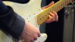 Man playing electric guitar on a stage - stock footage