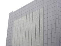 Outer wall of modern building over white - stock photo