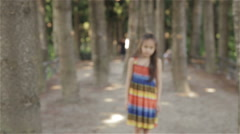 Young girl running towards camera and looking around in wonder - stock footage