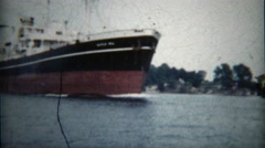 1960: Oceanliner broadside closeup from a small water vessel. - stock footage