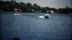 1960: Dad let's go of the rope while waterskiing in front of camera. Stock Footage