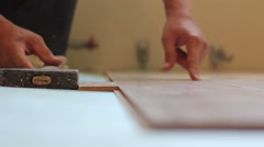 Man laying laminate Stock Footage