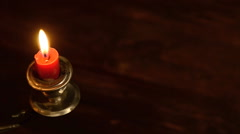 One candle flame at night. Stock Footage