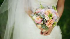 Bride holds a wedding bouquet in her hands Stock Footage
