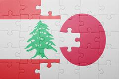 puzzle with the national flag of japan and lebanon - stock photo