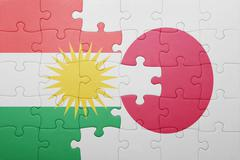 puzzle with the national flag of japan and kurdistan - stock photo