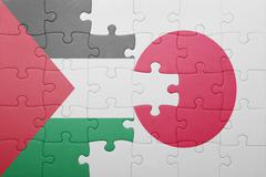 puzzle with the national flag of japan and palestine - stock photo