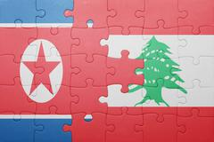 Stock Photo of puzzle with the national flag of lebanon and north korea