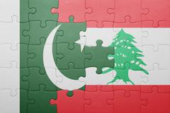 Stock Photo of puzzle with the national flag of lebanon and pakistan