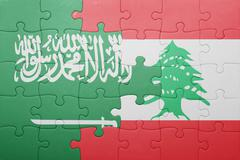 Stock Photo of puzzle with the national flag of lebanon and saudi arabia