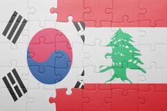 Stock Photo of puzzle with the national flag of lebanon and south korea