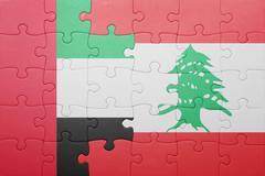 puzzle with the national flag of lebanon and united arab emirates - stock photo