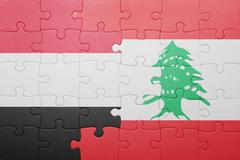 puzzle with the national flag of lebanon and yemen - stock photo
