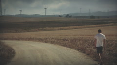 Man walks in windmillpark Spain, graded Stock Footage