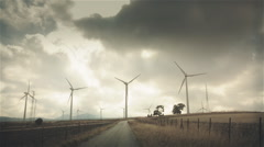 Empty road in Spanish windmillpark, graded Stock Footage