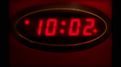 Time Lapse of Vintage Red Digital Clock running through Time - stock footage