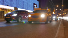Defocused video. Evening road traffic in the center of Moscow. Stock Footage