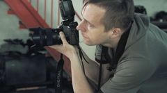 Stock Video Footage of Photographer shoots in auto service