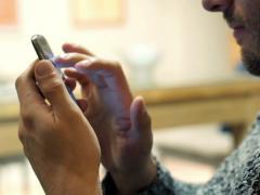 Male hands surfing net on smartphone  NTSC - stock footage