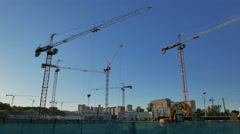 Excavators and cranes working on the construction of the residential complex. Stock Footage