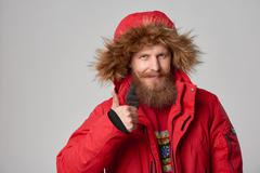 Bright picture of handsome man in winter jacket Stock Photos