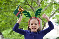 The girl celebrates the arrival of Christmas Stock Photos