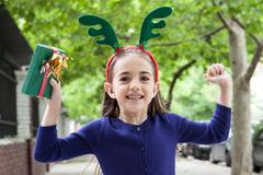 The girl celebrates the arrival of Christmas - stock photo
