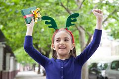 Stock Photo of The girl celebrates the arrival of Christmas
