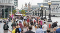 Crowds walking along London Riverside next to City Hall - stock footage