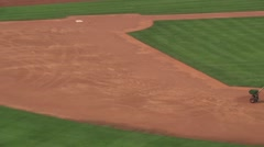 Men preparing baseball diamond for upcoming game - 02 Stock Footage