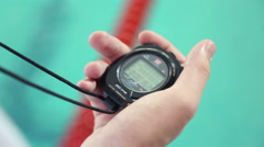 Hand of coach with a stopwatch - stock footage