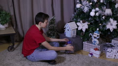 Boy gets opening gift and celebrating Christmas - stock footage