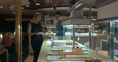 Family couple taking food in self-service restaurant Stock Footage