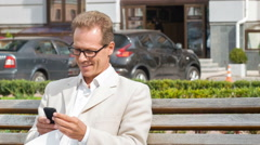 Businessman is texting outside Stock Footage