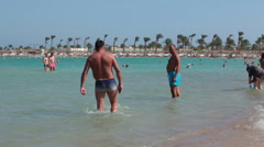 People swim in the Red Sea coastline. First line hotels area is on the Hurghada  Stock Footage