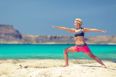 Yoga pose, fit woman exercise on beach Stock Photos