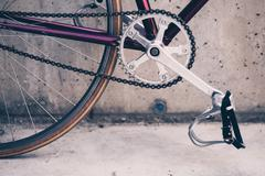 Stock Photo of Road bicycle and concrete wall, urban scene vintage style