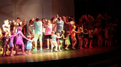 Children dance in line with animators on Egyptian hotel amphitheater stage Stock Footage